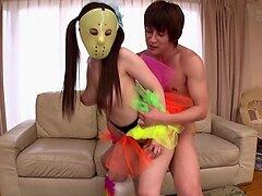 Babe with a mask enjoys a couple of erected Japanese cocks